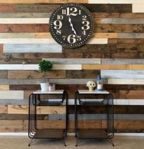 Two Side Tables in Front of a Wood Plank Wall with an Oversized Wall Clock