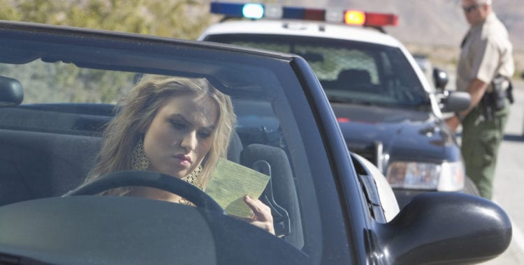photo of a person being pulled over by the police. time for a Traffic Ticket Lawyer